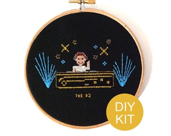 DJ Cross Stitch Kit. DIY kit with our DJ pattern includes golden metallic embroidery floss, fabric and hoop