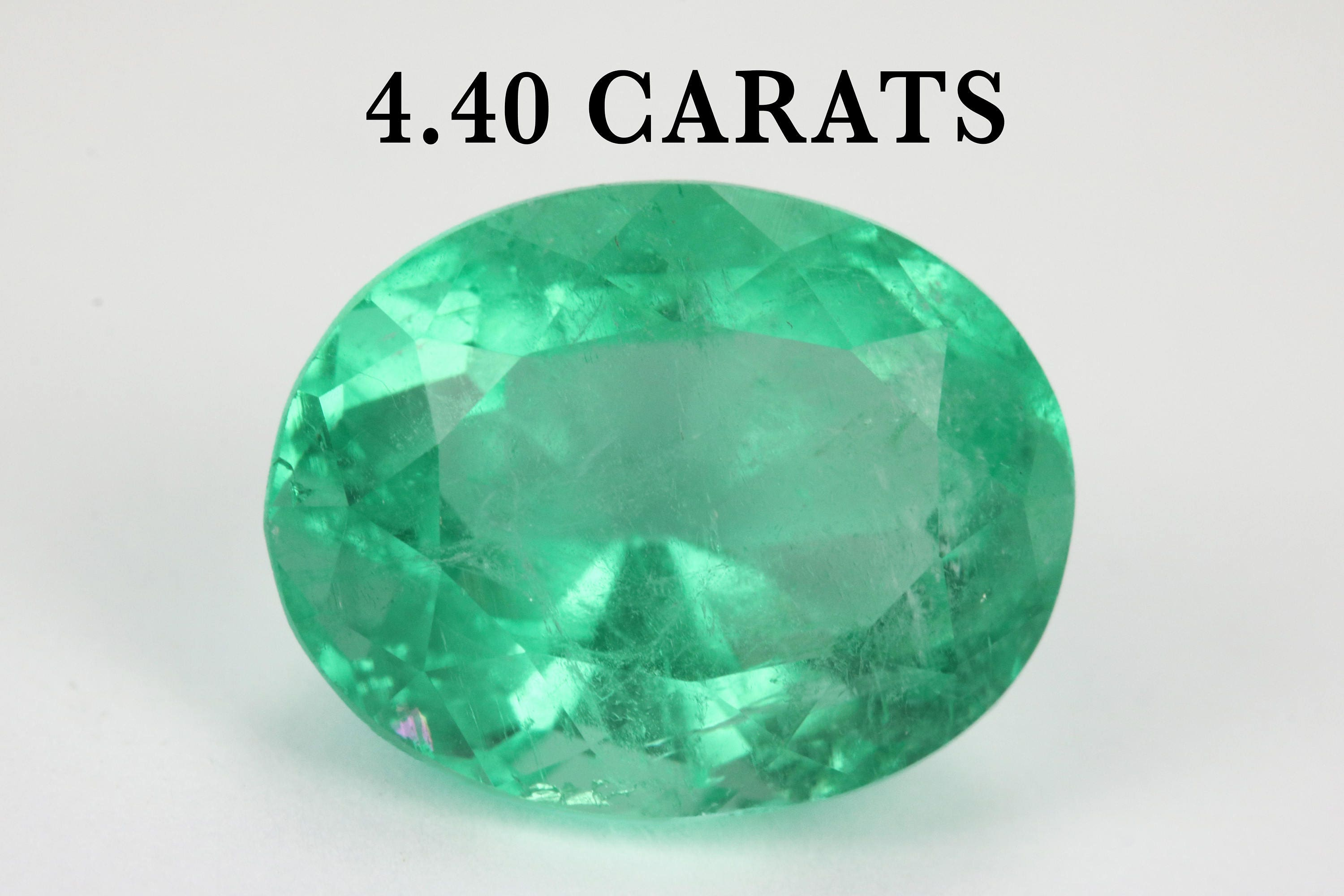 diamond on cabochon karat mile collections ring m sugarloaf emerald oval cut jewelers main gold white miracle regent jewelry and