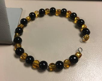 Black and amber beaded bracelet and earring set
