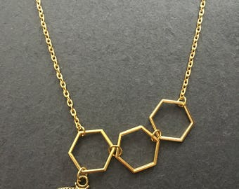Bee necklace, gold honeycomb/hexagons with gold bee charm