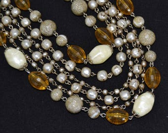 Vintage Necklace with Six Strands of Plastic Beads and Faux Pearls in Cream Gray and Yellow