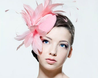 Feathered headpiece perfect for weddings, Ascots races, the Melbourne Cup.