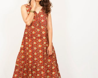 Bright apple red SHINE LIKE A MORNINGSUN dress, Block printed, relaxed fit flowy maxi dress with hi-low hem, ties at the back.