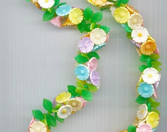 So pretty!  Vintage celluloid flower necklace signed West Germany