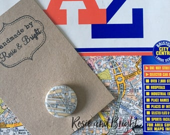 Map pin badge: 2.5cm pin badge featuring the location of your choice