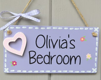 Personalised lilac door plaque with heart embellishment and hand painted flowers.