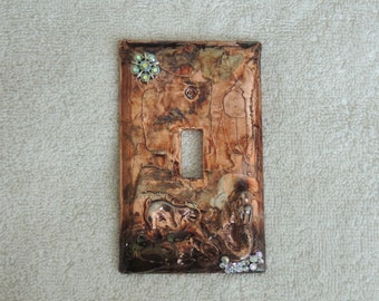 Covered bronze finish light switch platewith mermaid