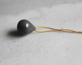 Dark gray handmade porcelain tear drop necklace on gold silk cord