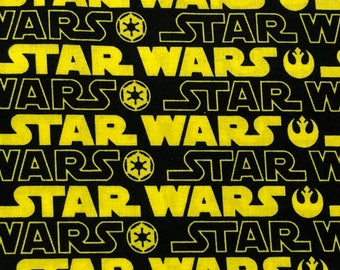 Fabric by the Yard - Star Wars Yellow and Black Logo