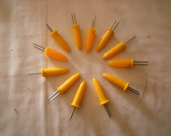 vtge 12 corn holders-yellow corn holders-dining and kitchen-serving pieces-plastic handles-metal picks-retro