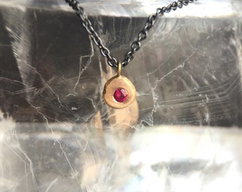 Solid 14 karat Gold Ruby and Oxidized Silver Ruby Pebble Charm Necklace