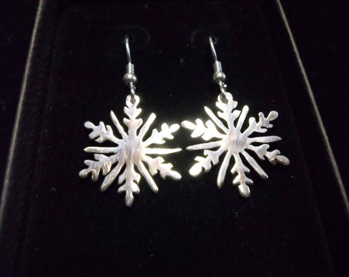 Snowflake earrings quarter size