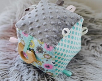 Soft block with teether rattle