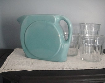 Fiesta-like periwinkle blue pitcher that needs a home