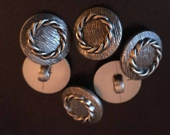 6 finished silver and black plastic buttons