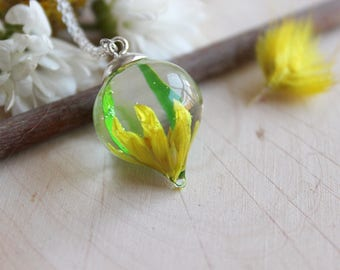Pendant drop and plastic yellow flower phalaris and bamboo leaf