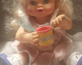 Bubble blowing doll