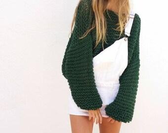 Chunky knit sweater, trendy green knitwear, oversized sweater, green pullover, green spring trends, chunky sweater, oversized sweater.