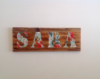 Reclaimed wood name plaque in RIFLE PAPER