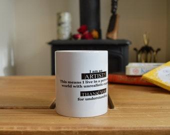 I AM AN ARTIST.  Mug