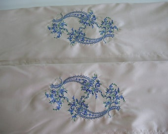Standard size pair of embroidered pillowcases - blue and green pattern