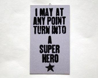 Original linocut * superhero *.