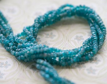 Fabulous Light Blue Apatite Faceted Rondelles Beads 3mm- 3.5mm 6 1/2 inch strand (10)