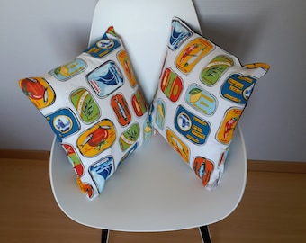 Patterned pillow cover with multicolored sardines, marine style boxes