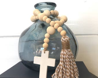 Classic bead strand with white cross and beige and white tassel