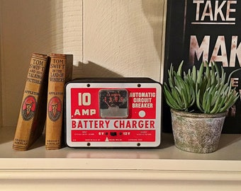 Vintage display 10 AMP battery charger red graphics 6v 12v sterling mfg Cleveland OHIO industrial