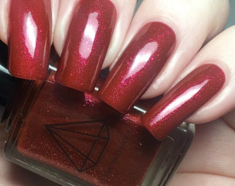 WW Handsome - a metallic red with pink sparkle BTS inspired UK handmade indie nail polish