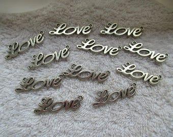 CONNECTEURS LOVE a deux boucles couleur argentée 3.3 cm lot de 11 unités pour toutes vos créations bijoux