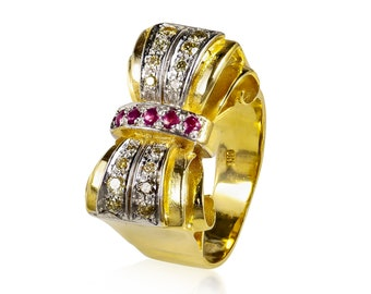English & 40's centory model bow ring Made out of 14k yellow gold  Studded with rubys and diamonds