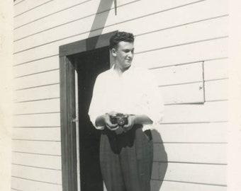 vintage photo 1954 Man w Camera Stands under Ladies Rest Room Bathroom