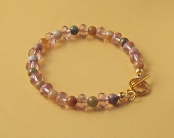Lovely beaded bracelet featuring Fancy Jasper gemstone with pale pink faceted crystal rondelle beads.