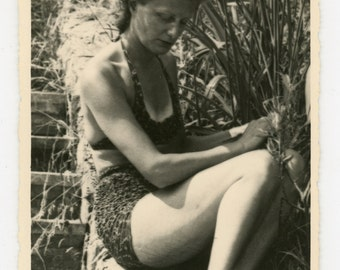 A quiet moment - original 40s/50s vintage photo of a lady wearing a bikini on a sunny day, sitting by herself, absorbed.
