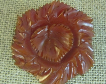 Vintage bakelite carved leaf brooch