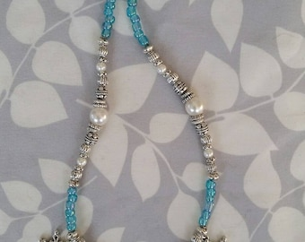 Elegant beaded snowflake necklace with pearl and Tibetan silver accents