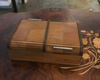 Roll top cigarette box