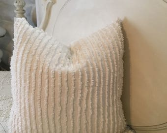 One 18/18 inch. Slightly cream vintage chenille pillow slip cover.  Linen backing .