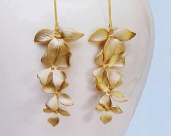 Flower earrings.   Wild Orchid flower cascade earrings in gold . four 4 orchids and a long earwire