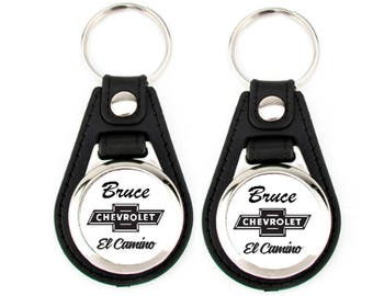 "EL CAMINO KEYCHAIN set with the custom name ""Bruce"" on the top."