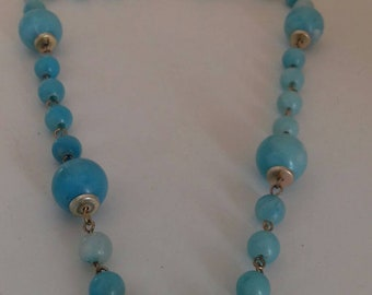 Blue vintage beaded necklace on silver chain.