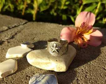 Starfish in the sand ring