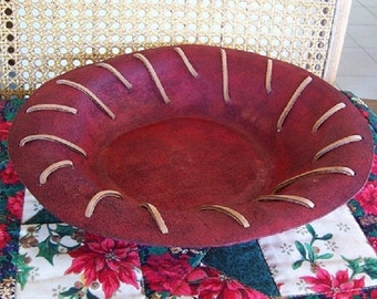 Decorative leather bowl with leather laceing