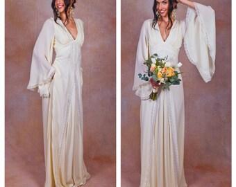 ivory pure silk bohemian wedding dress. Bell ANGEL SLEEVES. elegant boho wedding gown. POCKETS. empire waist. lace trim. deep v neckline.