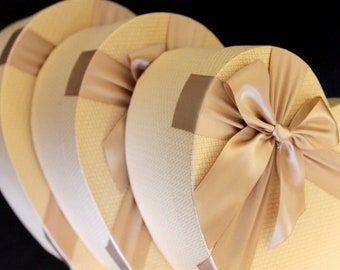 Luxurious GOLD heart shaped storage gift boxes with satin bow. Perfect for hair extensions.