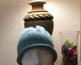 Turquoise knit hat with thin lavender stripe