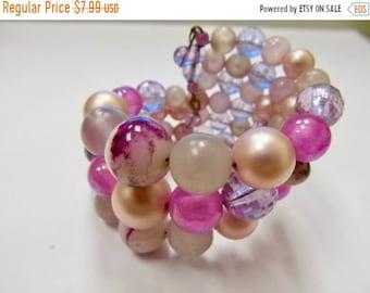 On Sale Vintage Pink and Purple Plastic Beaded Spiral Bracelet Item K # 2458