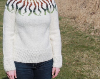 Off-white knit sweater with modern pattern made of pure icelandic wool.